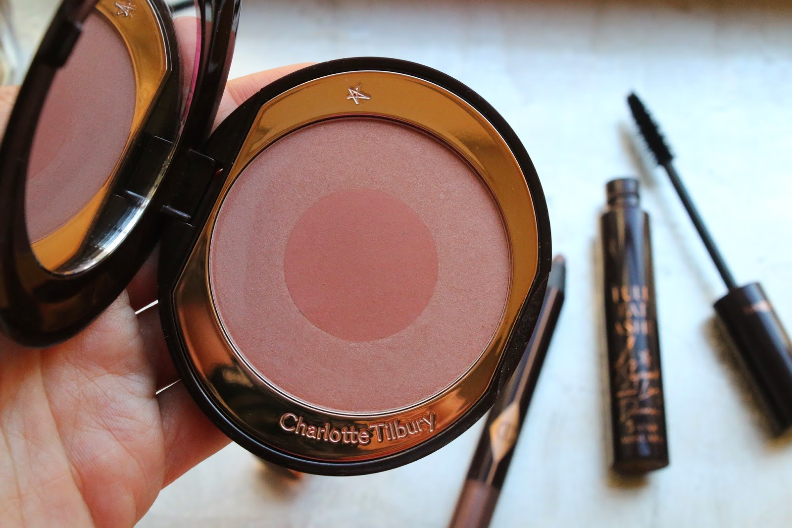 Charlotte Tilbury Cheek to Chic swatches on fair skin